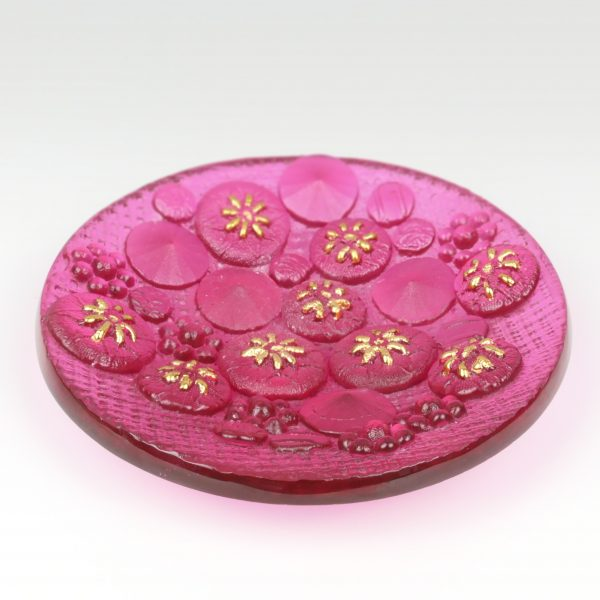 Pink glass bowl with flower pattern