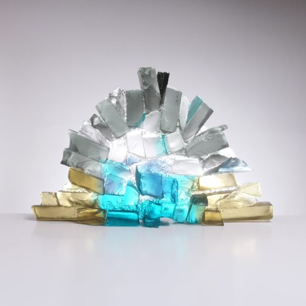 Glass sculpture in the form of a rocky wall